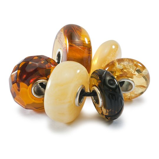 selection of amber designed trollbeads